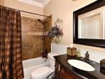 Full bath off kitchen & living room.