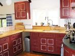 Hand made Edwardian style kitchen mainly by 'Chalon', with oak parquet floor, fully equipped.