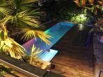 Pool at night with colourful lights