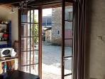 French doors opening from kitchen to courtyard