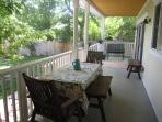 Our covered back porch features an Ipe dining set for 6.