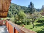 Two sets of french doors in the master bedroom open out to a balcony with mountain views