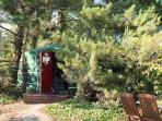Nestled amongst scots pine trees on a private peninsula