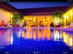 amazing at night around the pool