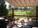 New covered deck with BBQ and golf course view of the 11th hole.