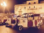 Ape taxi in the Piazza della Repubblica waiting for customers