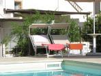 Solarium bordo piscina