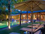 Villa Shambala - Pool chairs at night