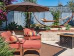 Private back patio with kick-your-feet-up comfort and lounging - hammock and fire-pit included.