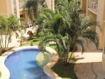Condo overlooking thecgarden and outdoor pool