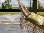 Handwoven Brazilian hammocks on the large covered deck overlooking Lilies very own lake.