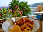 Try one of the seafood restaurants located along the coastline