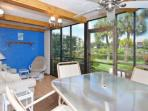 Glass and Screened Lanai with View out To Waterway