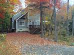 Brilliant fall foliage surrounds the home