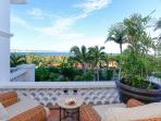 Lush gardens enclose the patio and villa