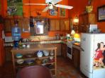 Fully equipped kitchen with special eating area.