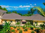 Tropical landscaping surrounds Villa Peace and Plenty Villa.