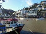 Fishing boats on East Looe quay. Buy day caught fresh fish at the market on the harbour!