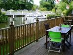 Private al fresco dining on the elevated decking with beautiful river views.