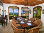 The formal dining room with a Caribbean view at a beautiful mahogany dining table for 8.