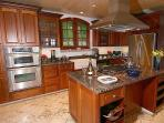 The gourmet kitchen is designed and equipped for the serious chef.