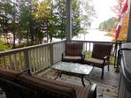 Deck off living room with patio furniture.
