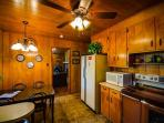 Kitchen with rich wood tones, sure to be warm and inviting for a