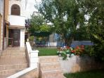 Two-Bedroom Apartment with Patio and views of the garden