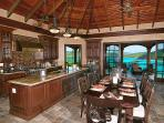 The Cinnamon Breeze chef's kitchen and dining area with a magnificent Caribbean view.