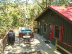 RED CREEK CABIN: Deck with hot tub, gas grill and outdoor dining.  Privacy fence (see other photo)