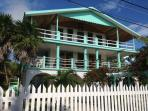 The Reef House is a Caribbean-style home with comfort, privacy and porches for enjoying sea breezes.