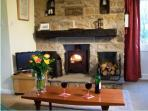 Enjoy the warmth from a wood-burning stove at Locka Old Hall Cottage