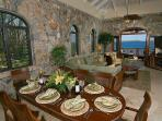 The Rhapsody St. John dining room, leading to the living room and lanai.