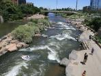 across foot bridge, confluence park with over 40 miles of running/biking rails connects cherry creek