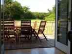 View out over decking and garden from Family room.