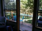 View from Sunroom.  Enjoy the outside Deck seating, gas grill, Lake Veiw and Timbered setting!