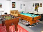 Games Room with pool table, air hockey, foosball and fishing rods