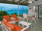A huge alfresco living/dining area with a modern kitchen overlooks the beautiful Caribbean.