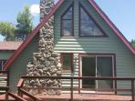 Cute, cozy, relaxed little cabin nestled in a .45 acre lot on the outskirts of town