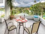Want to gaze at views of Phuket and the ocean? Take a seat near the balcony of Phuket condo rentals.