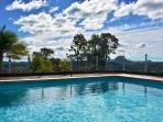 Guest solar-heated pool with mountain and valley views