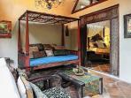 Daybed on the veranda of Little Vanilla Cottage