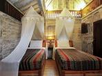 South Cabin ikat covered twin beds can be joined to form a queen.