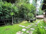 Garden in front of bungalows overlooks the ravine.