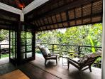 Villa upstairs veranda overlooking garden and pool