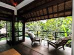 Villa upstairs veranda overlooking garden and pool