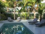 Villa Soleil Blanc the pool at sunset