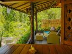 Big Balcony with great view of green rice pady and swimming pool.