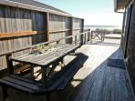 Large ocean facing wrap around deck, picnic table, charcoal BBQ and built-in bench seats