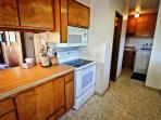 Fully equipped kitchen with all appliances, breakfast bar for 3, large pantry with a griddle, espresso machine, and...